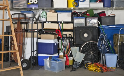 Full Garage with boxes and ladders