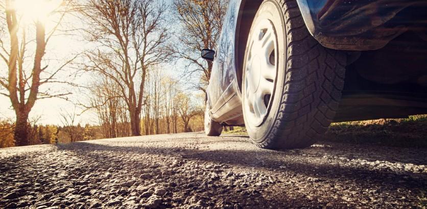 Car on asphalt road in spring morning