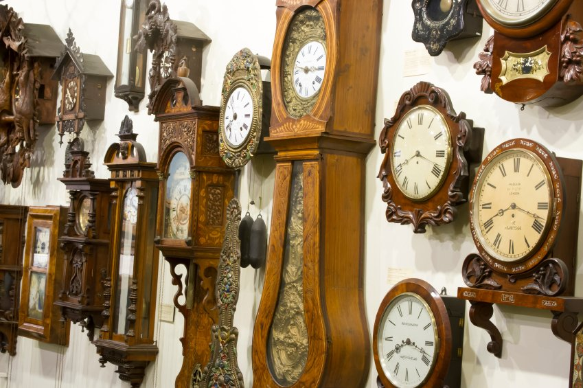 Collection of wooden clocks hanging on wall