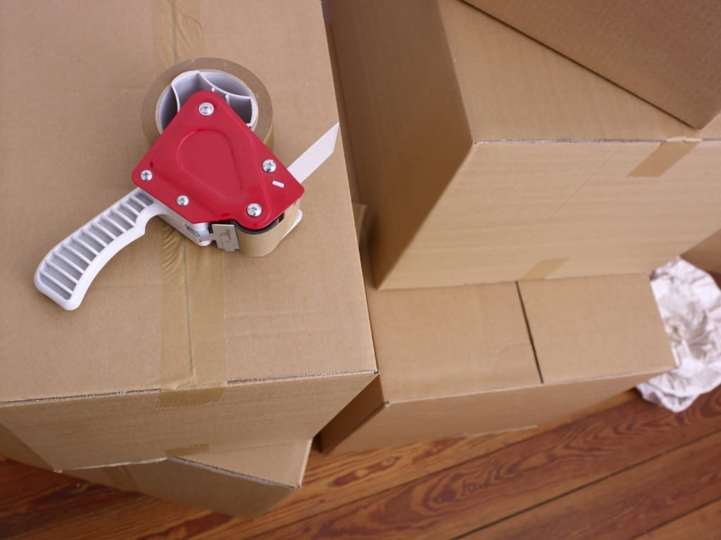 A stack of cardboard boxes and packing tape ready for self storage