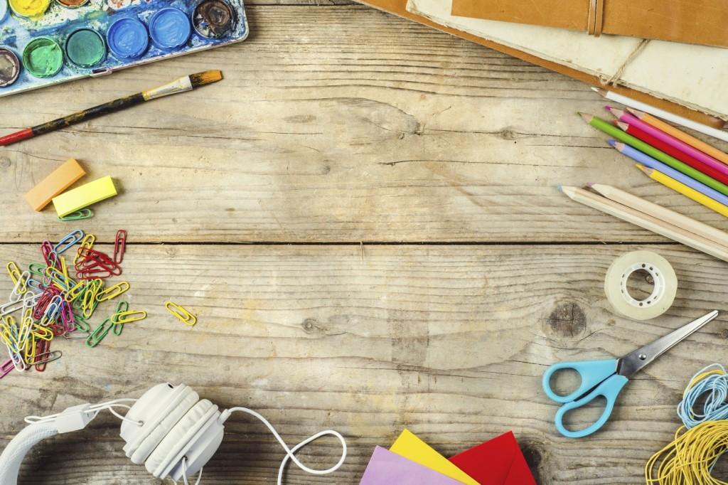 artist's desk with crafts supplies
