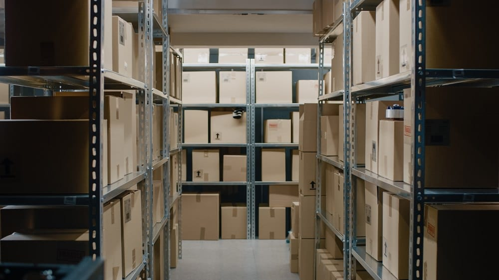 Shot Inside Storeroom with Rows of Shelves Full Cardboard Boxes, Parcels, Packages Ready For Shipment.