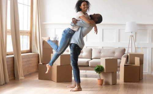 couple hugging after moving in