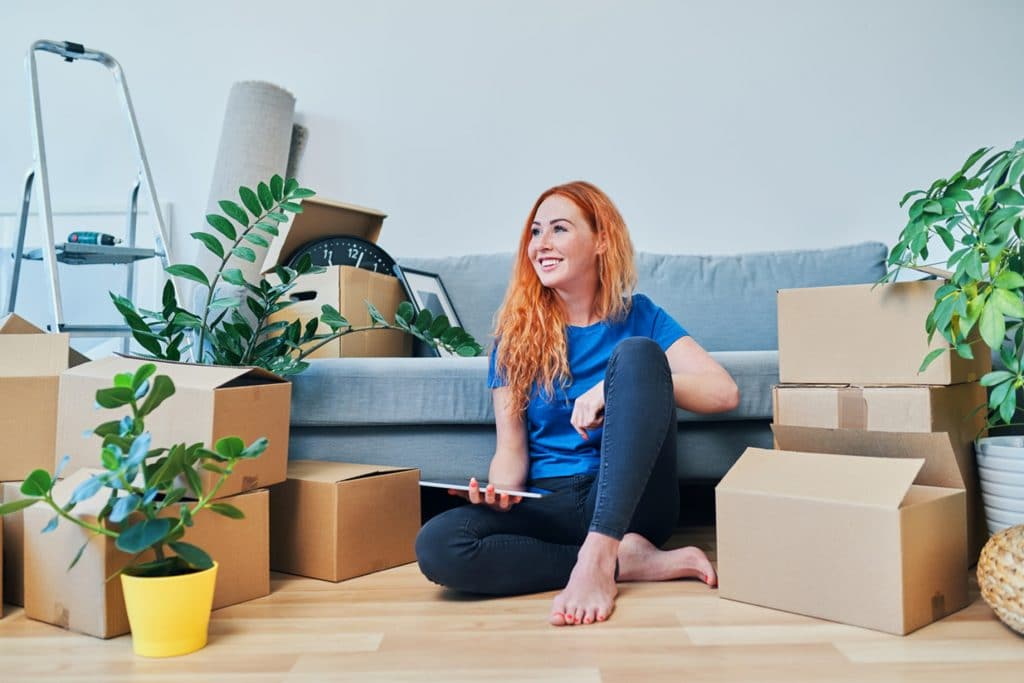 women wearing blue top smiling with storage around her