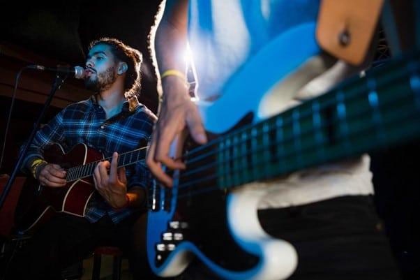 man singing with guitars