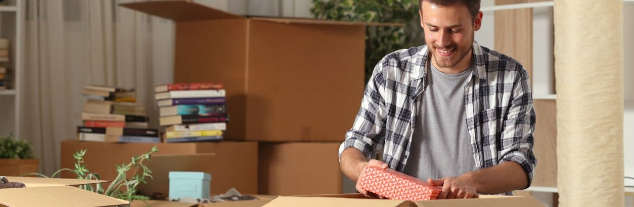 man smiling and packaging storage